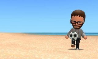 Tomodachi me playing football on the beach.