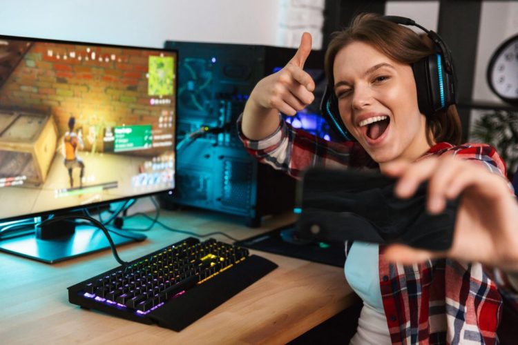 woman gamer taking a selfie while playing a multiplayer pc game